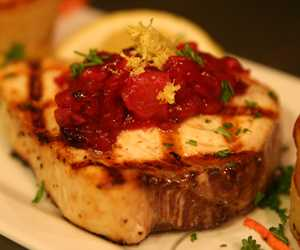 Grilled swordfish with a cranberry persimmon chutney