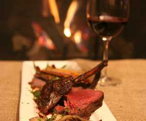 Grilled frenched rack of venison served with a hunter sauce and a fall heirloom pave'.
