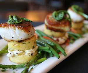 Grilled watercress polenta cakes, colossal sea scallops, ramp pesto and fiddlehead ferns