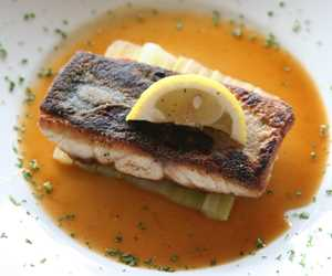 Pan seared sea bass on a raft of braised celery with a veal cognac reduction
